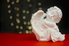 Christmas angel. On red with lights in background Royalty Free Stock Photos