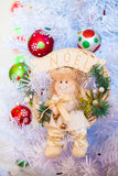 Christmas angel. Toy Christmas angel hanging on a white Christmas tree Royalty Free Stock Image