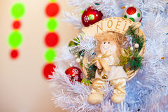 Christmas angel. Toy Christmas angel hanging on a white Christmas tree Royalty Free Stock Images