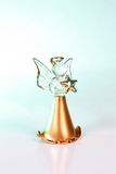 Christmas angel. Glass angel Christmas ornament surrounded by colored light Stock Photos