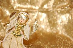Christmas angel. Toy with golden decoration Stock Images