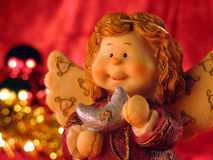 Christmas angel. With a little present for you Royalty Free Stock Photos