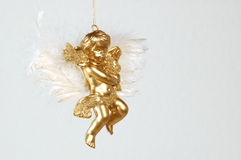 Christmas angel. Golden christmas tree decoration - angel with feathered wings Royalty Free Stock Image