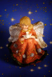 Christmas angel. With starred background and vignette effect Stock Photography