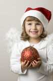 Christmas Angel. With red glass ball Royalty Free Stock Image