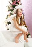 Christmas angel. Six years old little blond girl acting as Christmas angel Stock Image