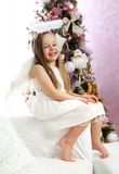 Christmas angel. Six years old little blond girl acting as Christmas angel stock photography