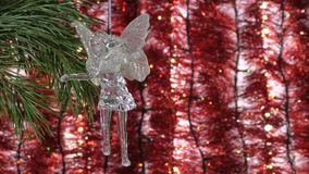 Christmas angel on a background of garlands. Blurred Lights Bokeh Background. stock footage
