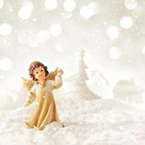 Christmas angel. Christmas background with angel, christmas tree and snow Royalty Free Stock Photo