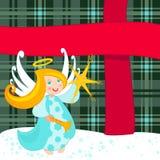 Christmas angel and big present Royalty Free Stock Photo