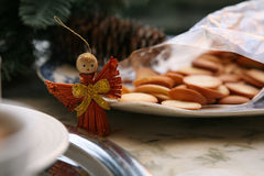 Christmas angel and biscuits Royalty Free Stock Images