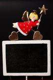Christmas angel with blackboard Stock Images