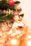 Christmas angel with book in gold royalty free stock image