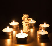 Christmas angel with candles Stock Images
