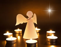 Christmas angel with candles Stock Photos