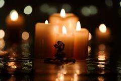 Christmas angel with candles. Christmas angel against four burning candles in the background Royalty Free Stock Photography