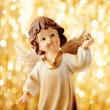 Christmas angel. Decoration and golden christmas lights Stock Images