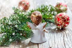 Christmas angel, fir branch and red ball. Royalty Free Stock Images