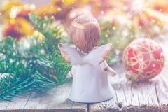 Christmas angel and fir branch with toys. Royalty Free Stock Image