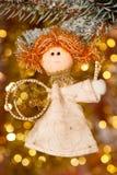Christmas angel on fir tree branch Royalty Free Stock Photo
