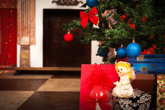 Christmas angel with a fireplace on background. Studio shot Royalty Free Stock Images