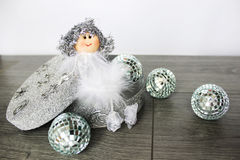 Christmas angel. In a furry outfit with toys Royalty Free Stock Image