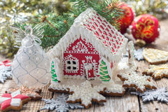 Christmas angel and a gingerbread house. Royalty Free Stock Photography