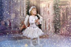 Christmas angel girl. In white clothes Stock Image