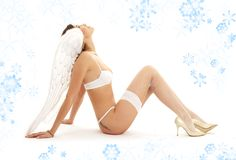 Christmas angel girl in white lingerie looking up Stock Photo