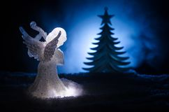 Christmas Angel glass xmas figure and glass fir tree, christmas tree, docorative elements on dark background. Christmas decoration Stock Photography