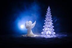 Christmas Angel glass xmas figure and glass fir tree, christmas tree, docorative elements on dark background. Christmas decoration. Angel xmas concept royalty free stock image