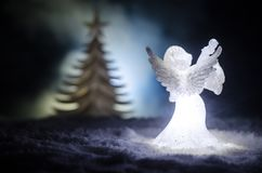 Christmas Angel glass xmas figure and glass fir tree, christmas tree, docorative elements on dark background. Christmas decoration Royalty Free Stock Photo