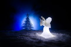 Christmas Angel glass xmas figure and glass fir tree, christmas tree, docorative elements on dark background. Christmas decoration Royalty Free Stock Photography