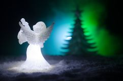 Christmas Angel glass xmas figure and glass fir tree, christmas tree, docorative elements on dark background. Christmas decoration. Angel xmas concept Royalty Free Stock Photos