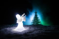 Christmas Angel glass xmas figure and glass fir tree, christmas tree, docorative elements on dark background. Christmas decoration. Angel xmas concept Stock Images