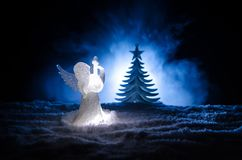 Christmas Angel glass xmas figure and glass fir tree, christmas tree, docorative elements on dark background. Christmas decoration. Angel xmas concept Royalty Free Stock Photo