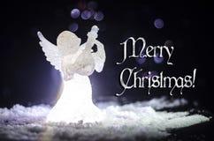 Christmas Angel glass xmas figure and glass fir tree, christmas. Tree, docorative elements on dark background. Christmas decoration angel xmas concept stock image
