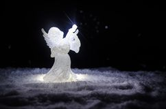 Christmas Angel glass xmas figure and glass fir tree, christmas tree, docorative elements on dark background. Christmas decoration. Angel xmas concept royalty free stock photography