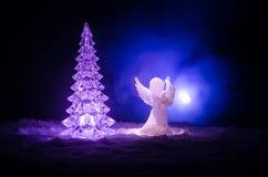 Christmas Angel glass xmas figure and glass fir tree, christmas tree, docorative elements on dark background. Christmas decoration. Angel xmas concept stock image