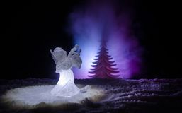 Christmas Angel glass xmas figure and glass fir tree, christmas tree, docorative elements on dark background. Christmas decoration. Angel xmas concept Stock Photography