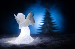 Christmas Angel glass xmas figure and glass fir tree, christmas tree, docorative elements on dark background. Christmas decoration. Angel xmas concept Royalty Free Stock Images