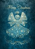 Christmas angel card with Marry Christmas wishes. Christmas angel with golden snowflakes decoration and Marry Christmas wishes on azure grunge texture Royalty Free Stock Image