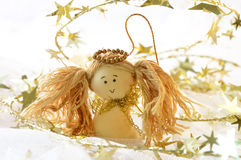 Christmas Angel. With golden stars on a white background Stock Photography