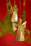 Christmas angel with green stars Royalty Free Stock Image