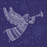 Christmas angel with horn and snow Royalty Free Stock Photo