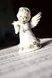 Christmas angel playing the flute. Ceramic christmas angel playing carols on the flute Stock Photography