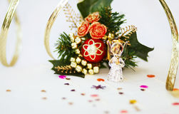 Christmas angel praying on dinner table. Christmas glass angel on dinner table with decoration and golden ribbons. Shallow depth of field royalty free stock images