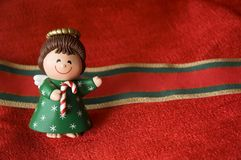 Christmas angel on red background Stock Photos