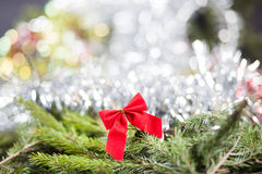 Christmas Angel. Red bow decoration on a Christmas tree branch Royalty Free Stock Photos