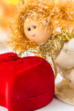 Christmas angel and red velvet heart Royalty Free Stock Image